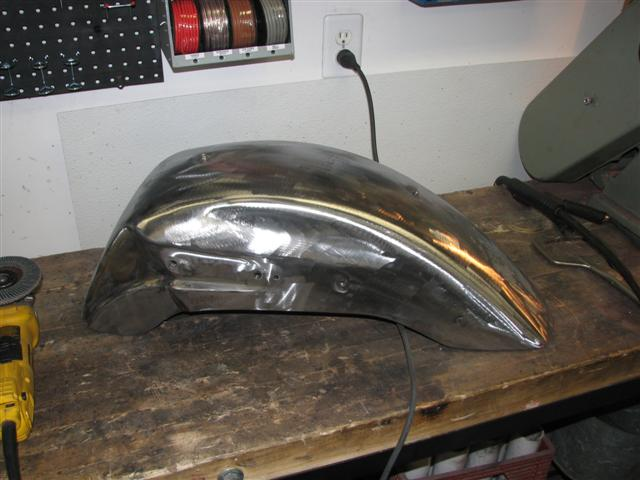 The rear fender after filling the old rear tail light and the old mounting holes for the side markers.
