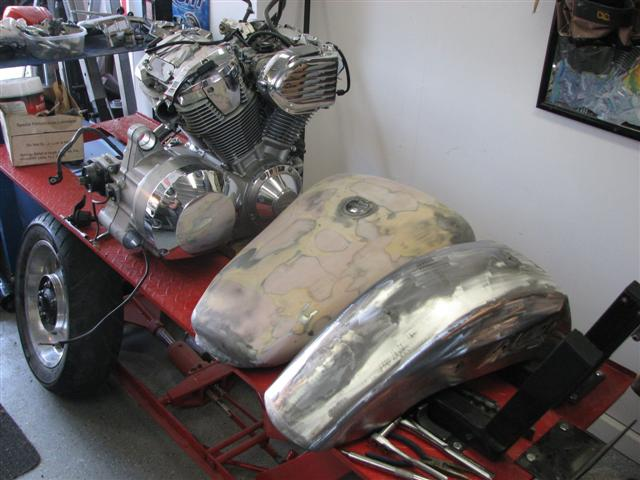 The tank, rear fender and the motor ready for paint.