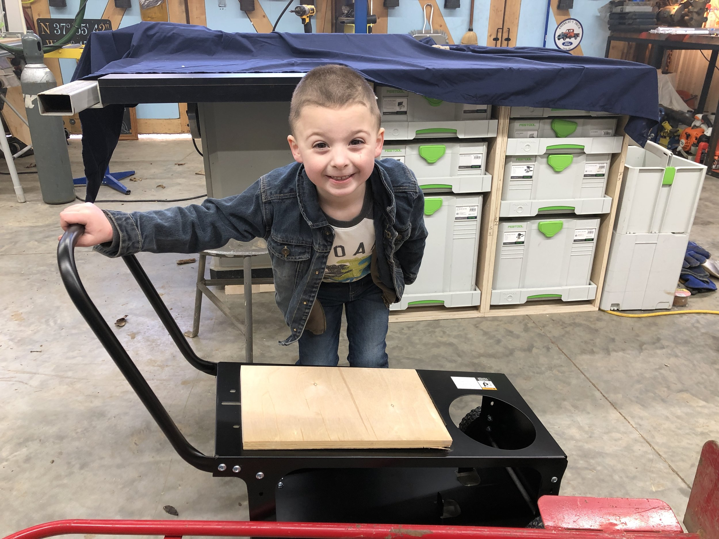 Luke putting together the new Welding Cart