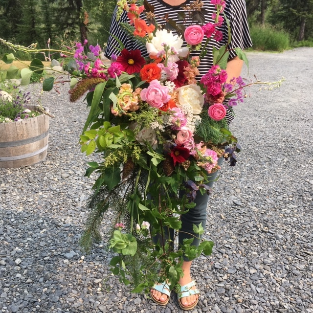 All local Alaskan flowers in a large, lush, cascading bouquet.
