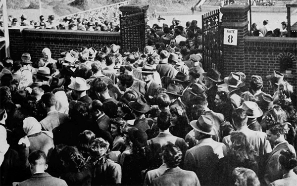 """""""Students crowd into the stadium to cheer UC to victory"""" (UC Libraries)"""
