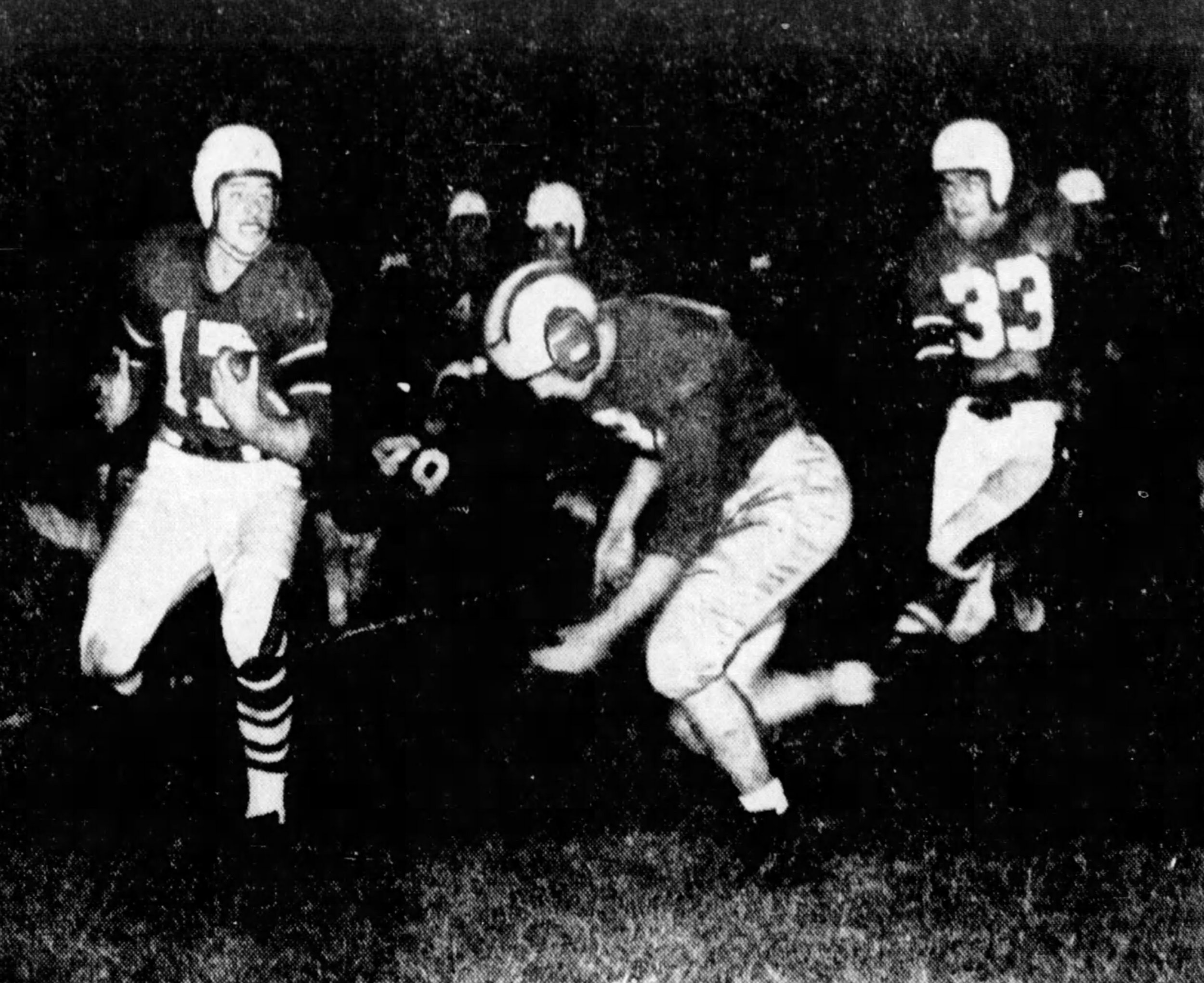 The Bearcats carry the ball on the game's opening play. To the right, #33 is Bearcat (and future Steeler) legend Elbie Nickel. (Enquirer)