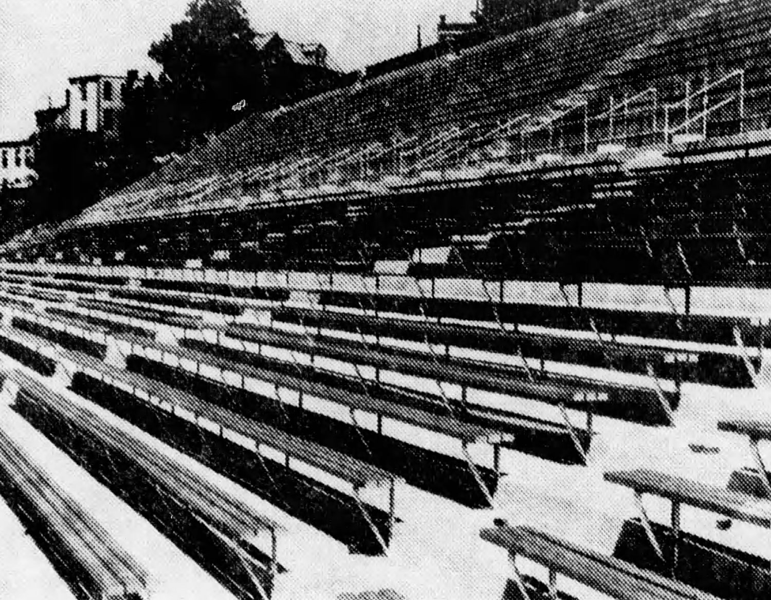 New wooden bleachers, installed to elevate fans from the old, concrete seats. [Enquirer]