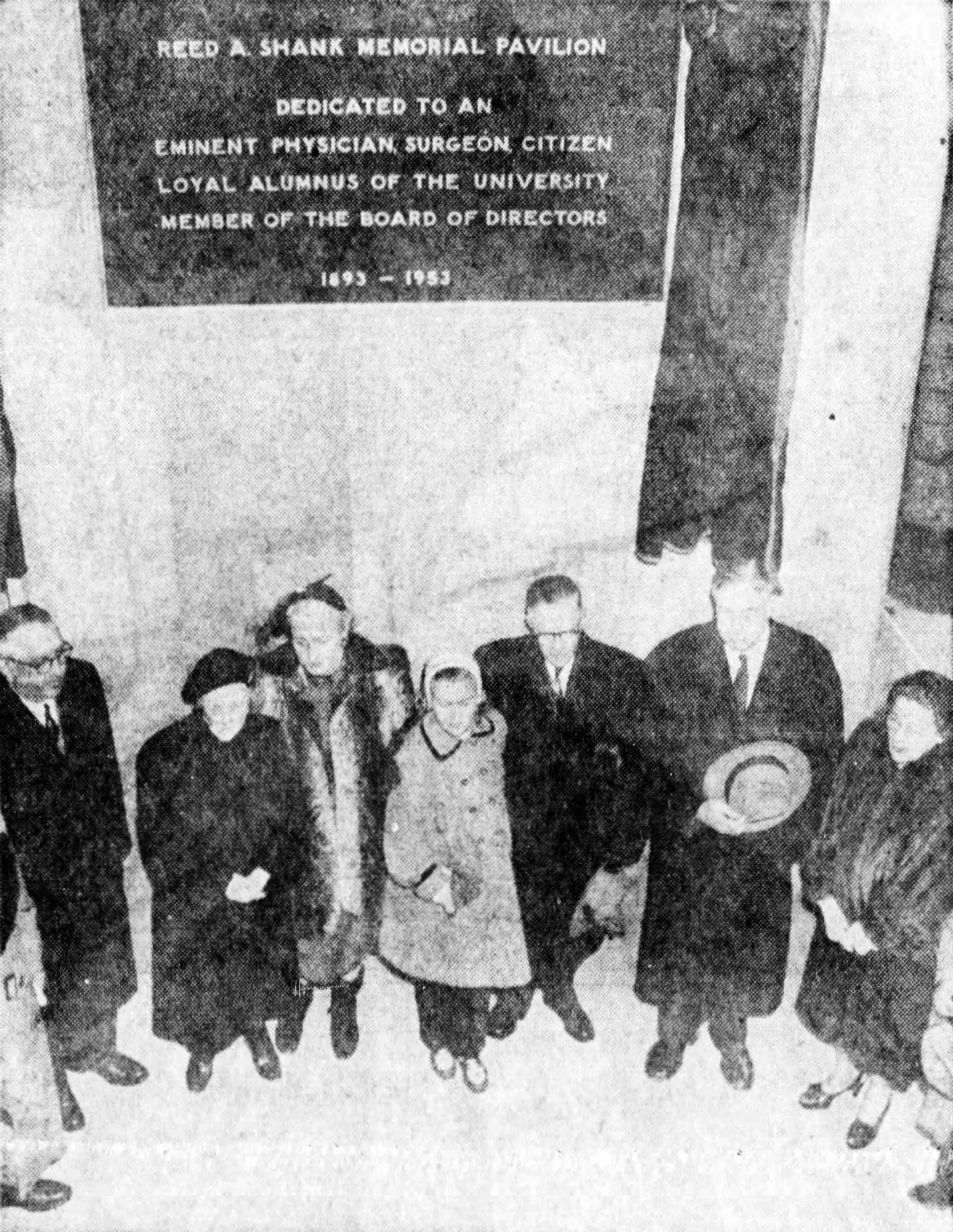 Mrs. Shank (far right) and other Shank family members pose with UC officials in front of the new dedication plaque—November 25, 1954 [Enquirer]