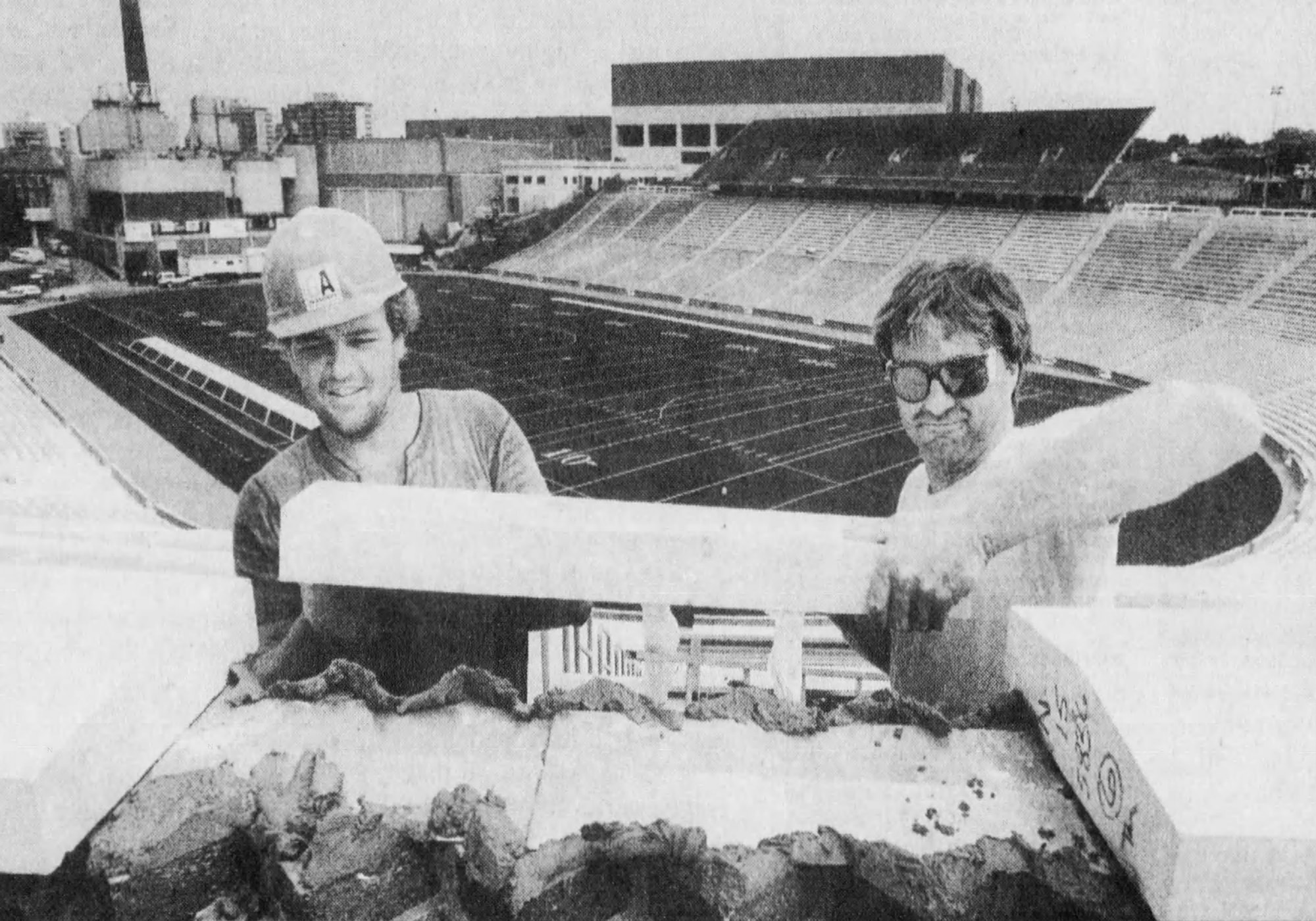 Construction workers place a limestone slab in the southwest corner of Nippert Stadium, 1991. [Enquirer]