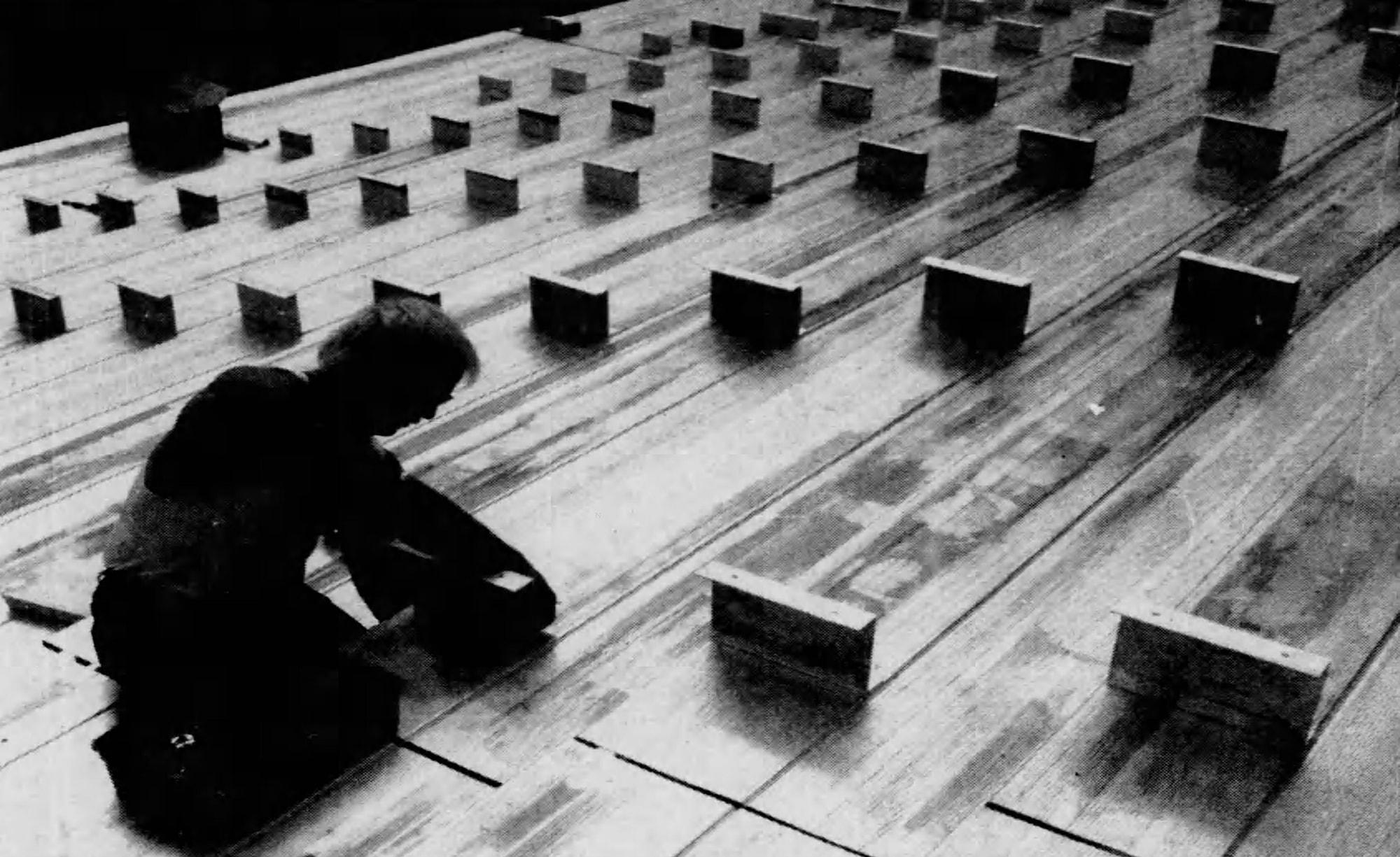 A worker installs bleachers at the north end of Nippert Stadium, 1992. [Enquirer]