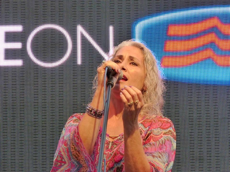 """Julie Scipioni singing, """"Lift Me Up"""" at the Festival della Communicazione in Camogli, Italy."""