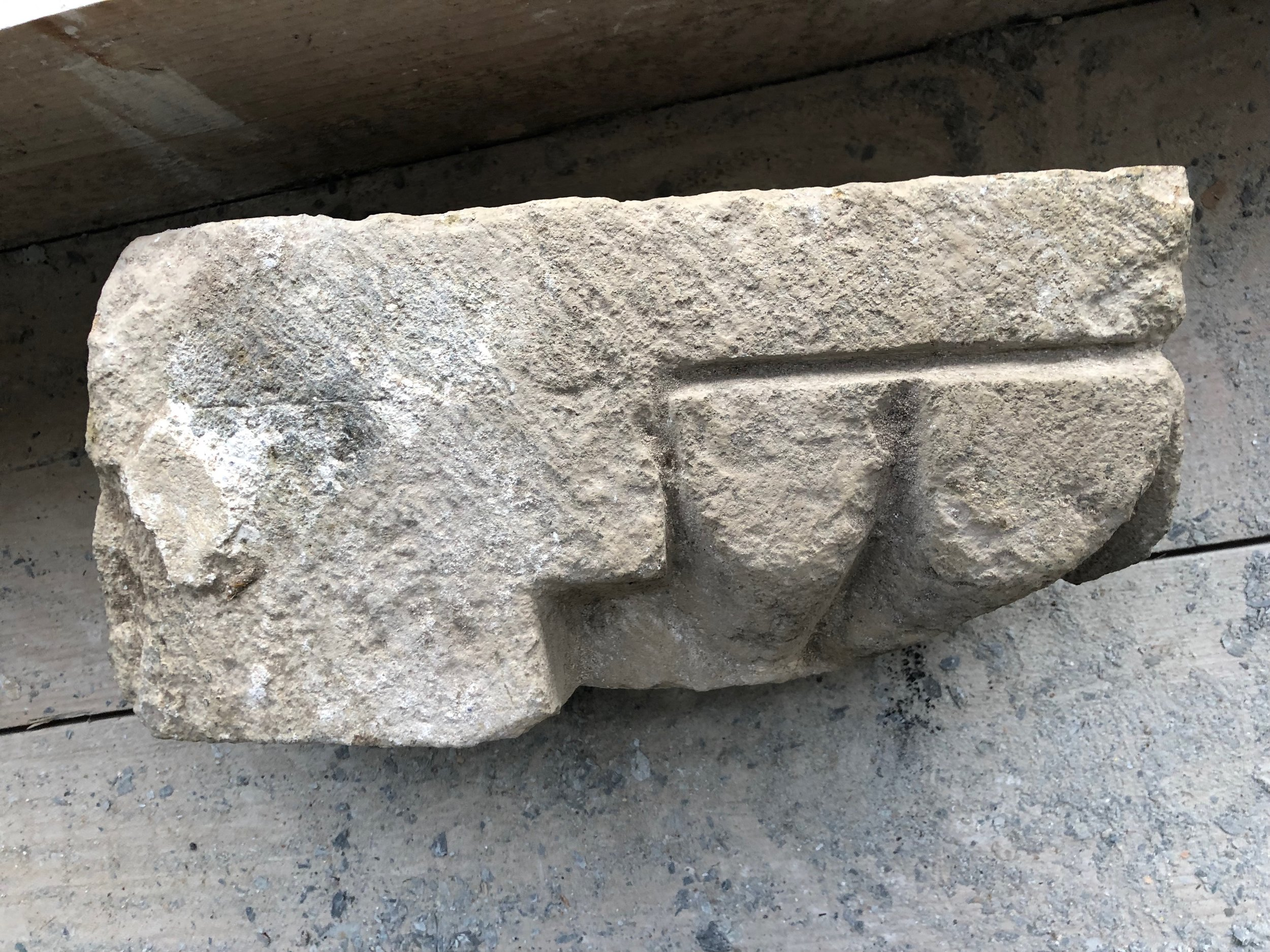 early capital for a door pillar with a small piece of plaster left on it. probably dating from around 1150 AD