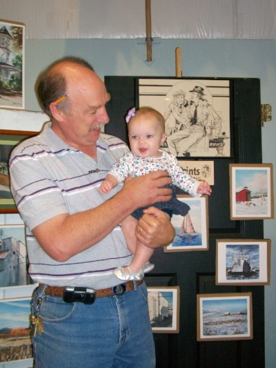 Tom, pictured with his granddaughter, Amara.