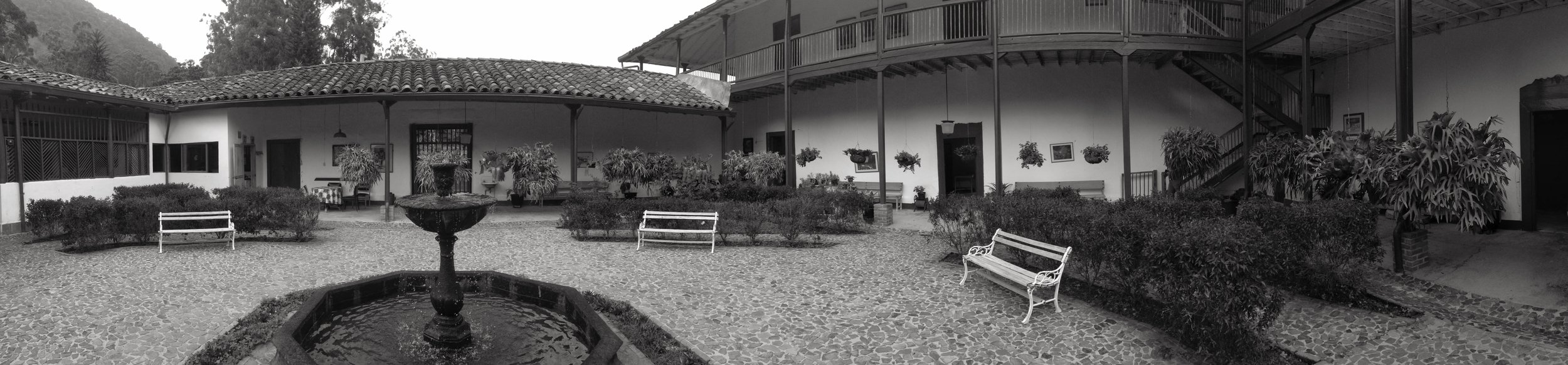 A panorama of the courtyard of a coffee farmhouse in Colombia