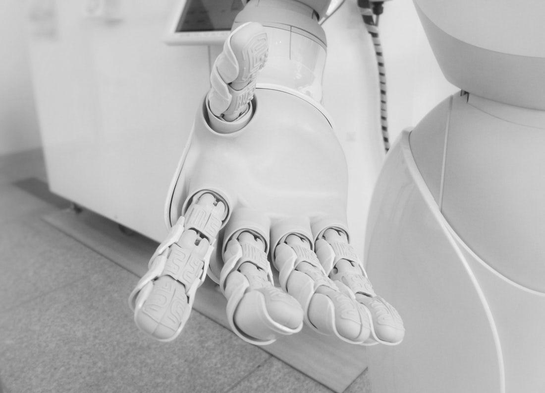 A robotic hand reaches towards the camera