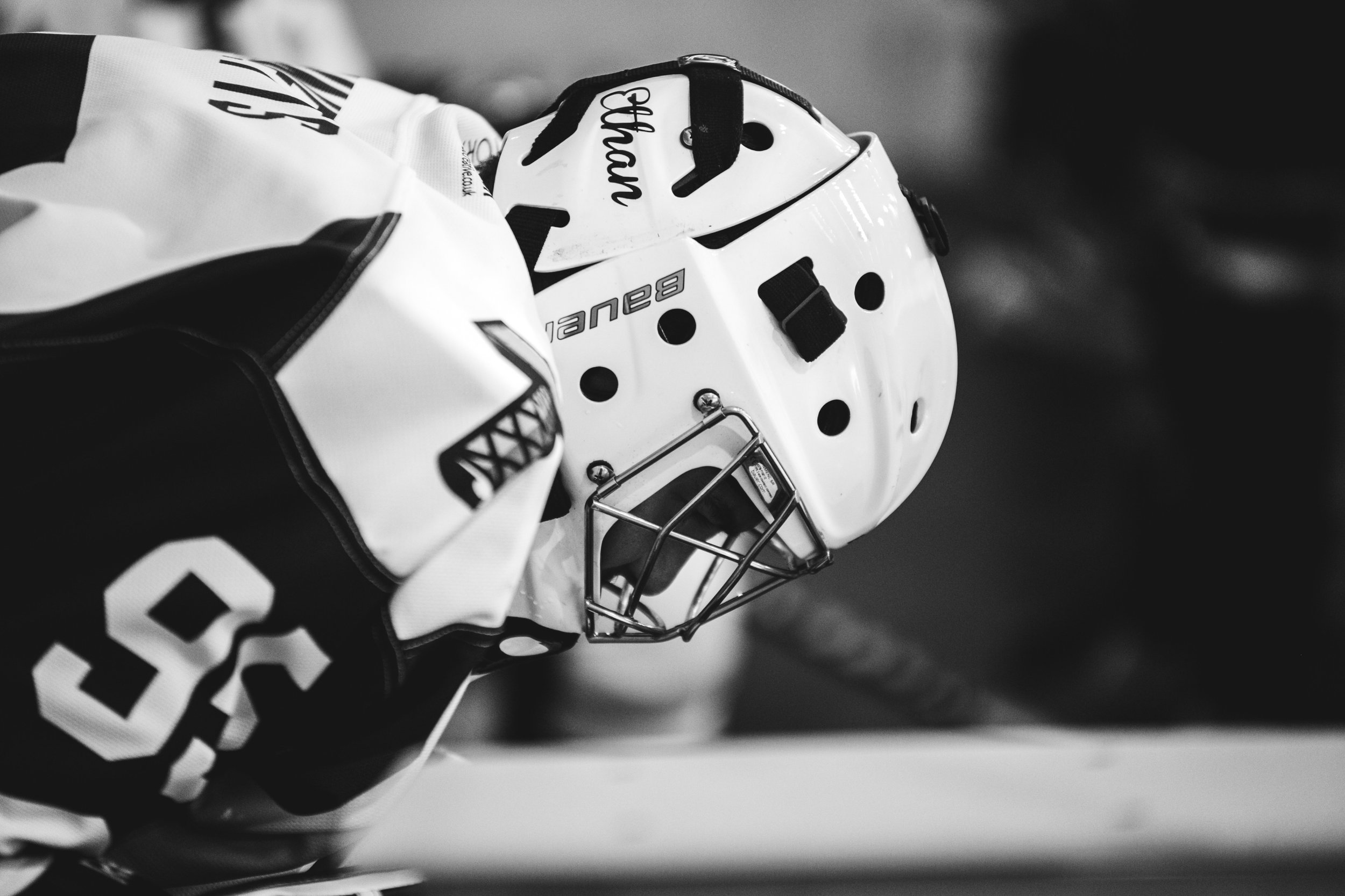 A hockey player wearing a helmet