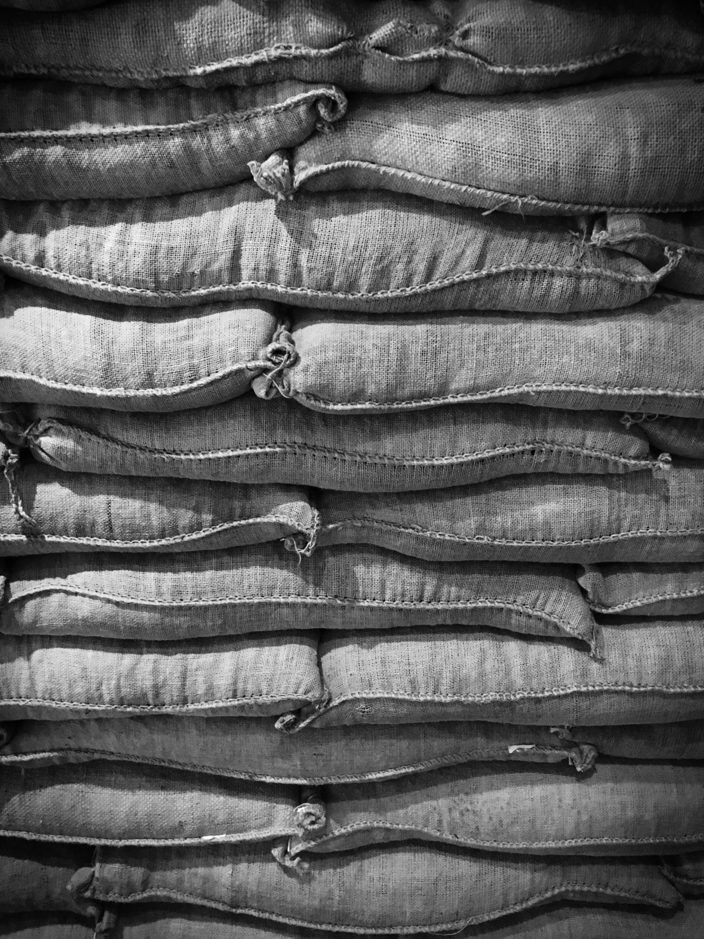 Sacks of coffee stacked up on atop another