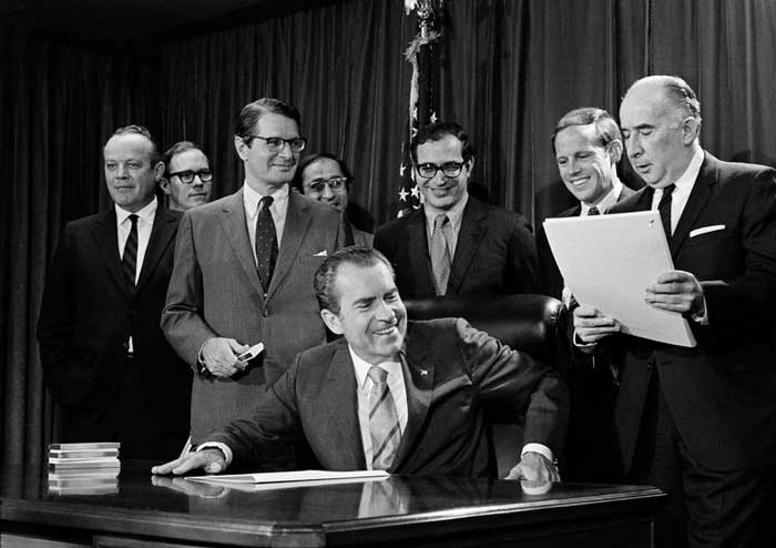 President Richard M. Nixon with Attorney General John Mitchell, right, after signing the Controlled Substances Act in Washington D.C., Oct 27, 1970. (AP Photo)