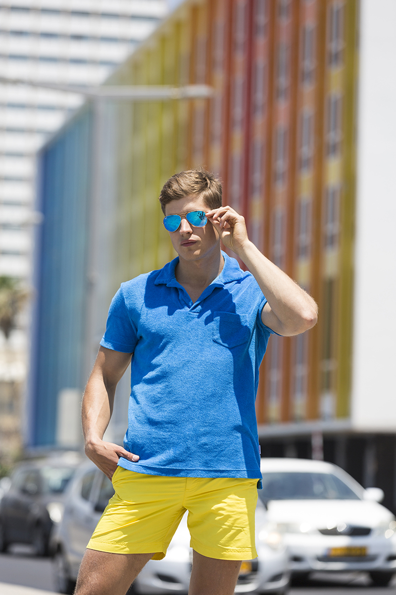 Shorts and polo by  Orlebar Brown , sunglasses by  River Island