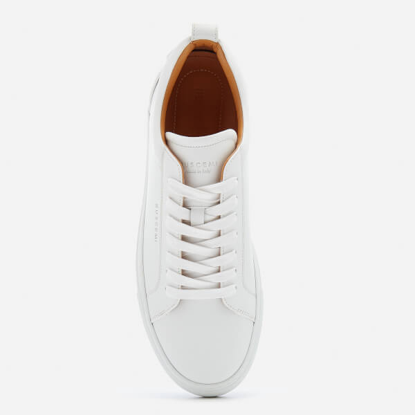 Buscemi sneakers at Coggles - £505 - Because you can NEVER have enough pairs of box fresh white sneakers.