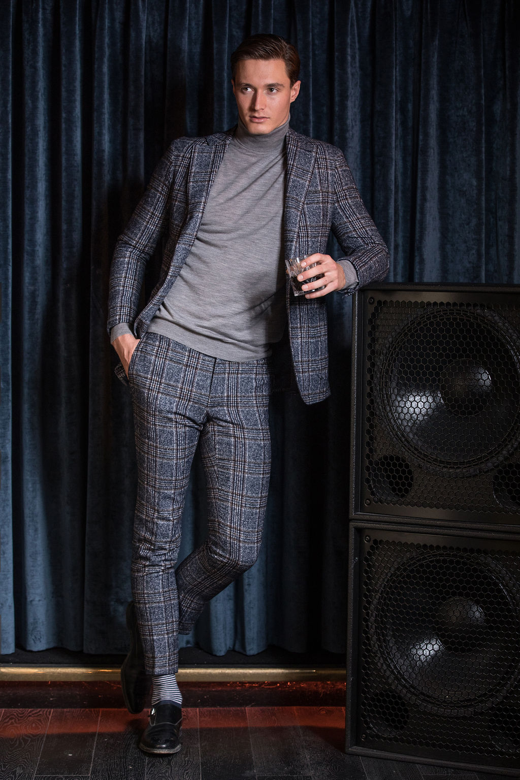 Huw wears suit by  Tailor Made London ,  John Smedley  roll neck and  Gieves & Hawkes  shoes
