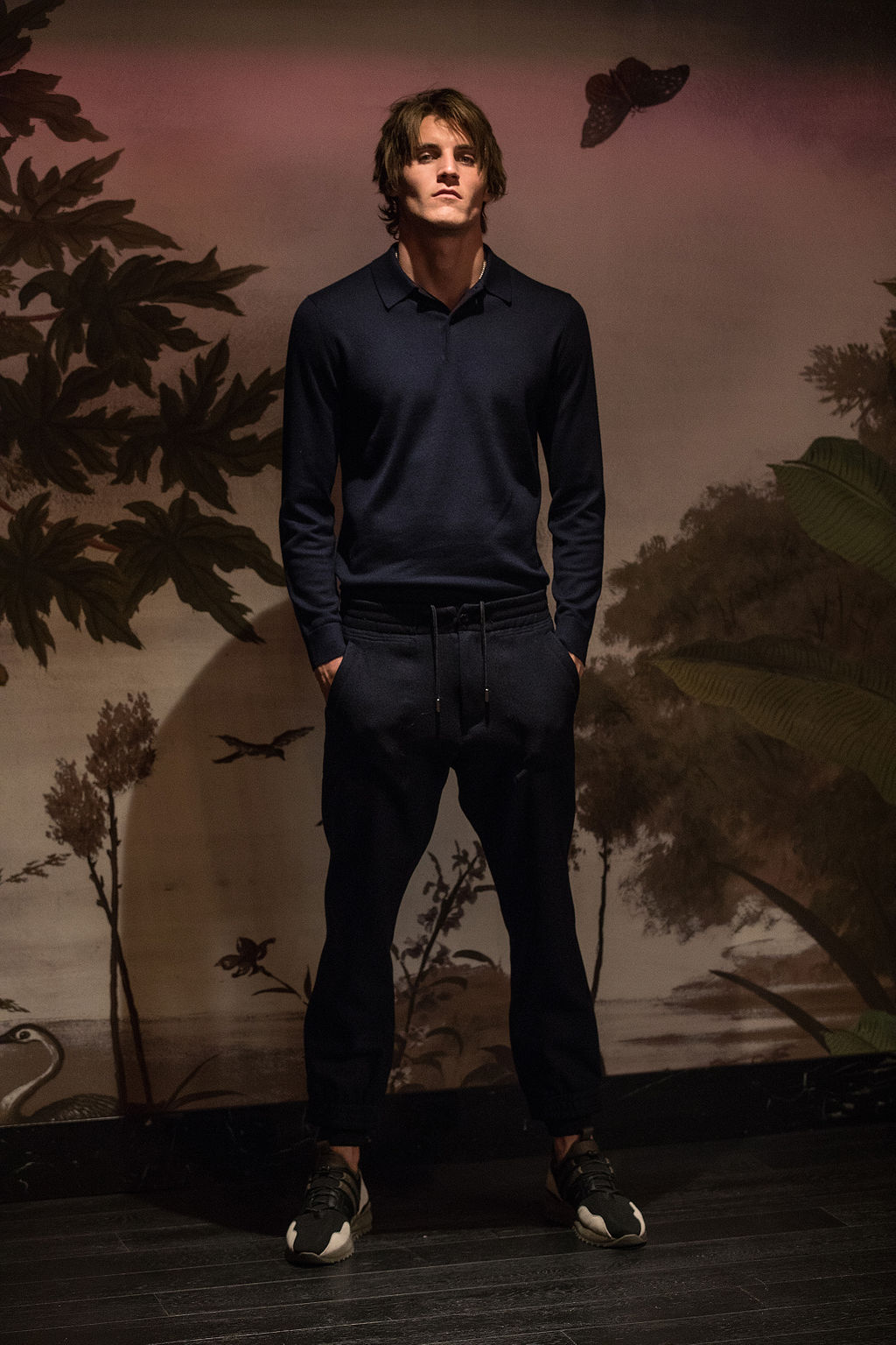 Jack wears polo shirt by  Gieves & Hawkes  with  Cerruti  joggers and sneakers