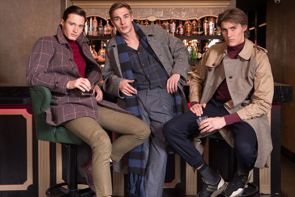 Huw wears  Basic Rights  trousers,  John Smedley  roll neck,  Cerruti  shoes and  Gieves & Hawkes  coat  Tommy wears all  E Tautz  with  Crockett & Jones  shoes  Jack wears  Cerruti  joggers and sneakers,  Grenfell  coat and  Gieves and Hawkes  polo neck