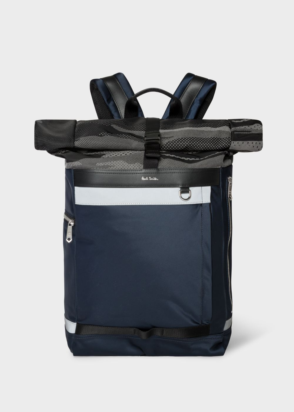 Paul Smith backpack - £395 - Constructed from navy satin fabric with leather trims, this men's backpack features a reflective camo print roll top which is secured with a squeeze clip