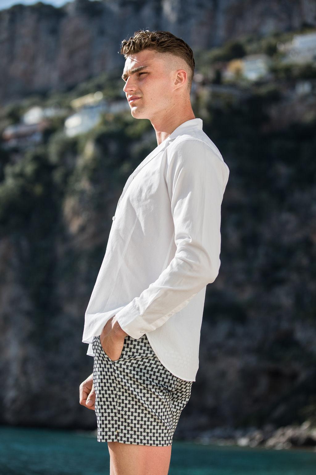 Harry wears  Orlebar Brown