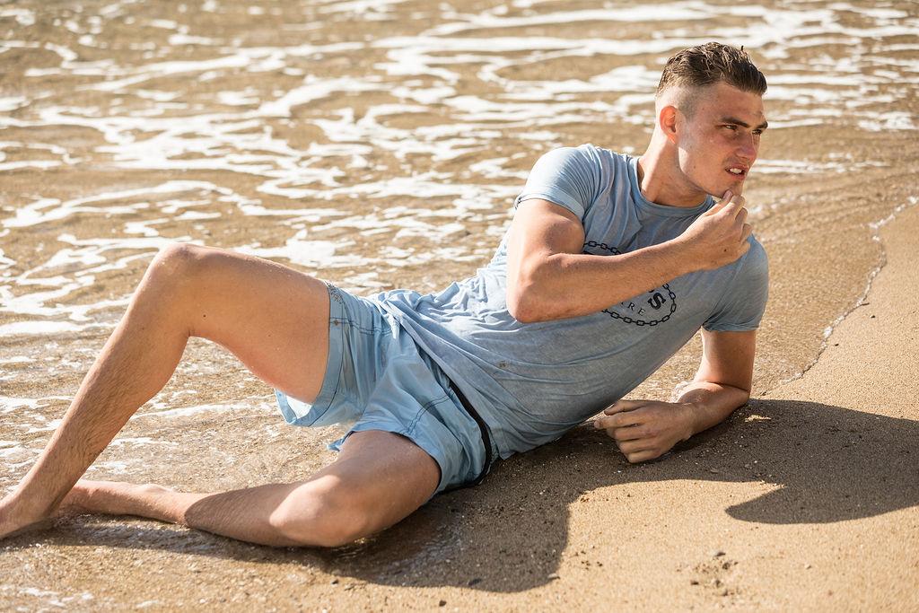 Harry wears  Daniel w. Fletcher  T-shirt &  Boardies x Daniel w Fletcher  shorts