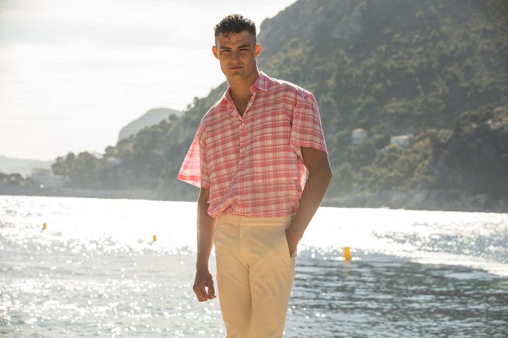 Harry wears  E Tautz  shirt &  Orlebar Brown  trousers