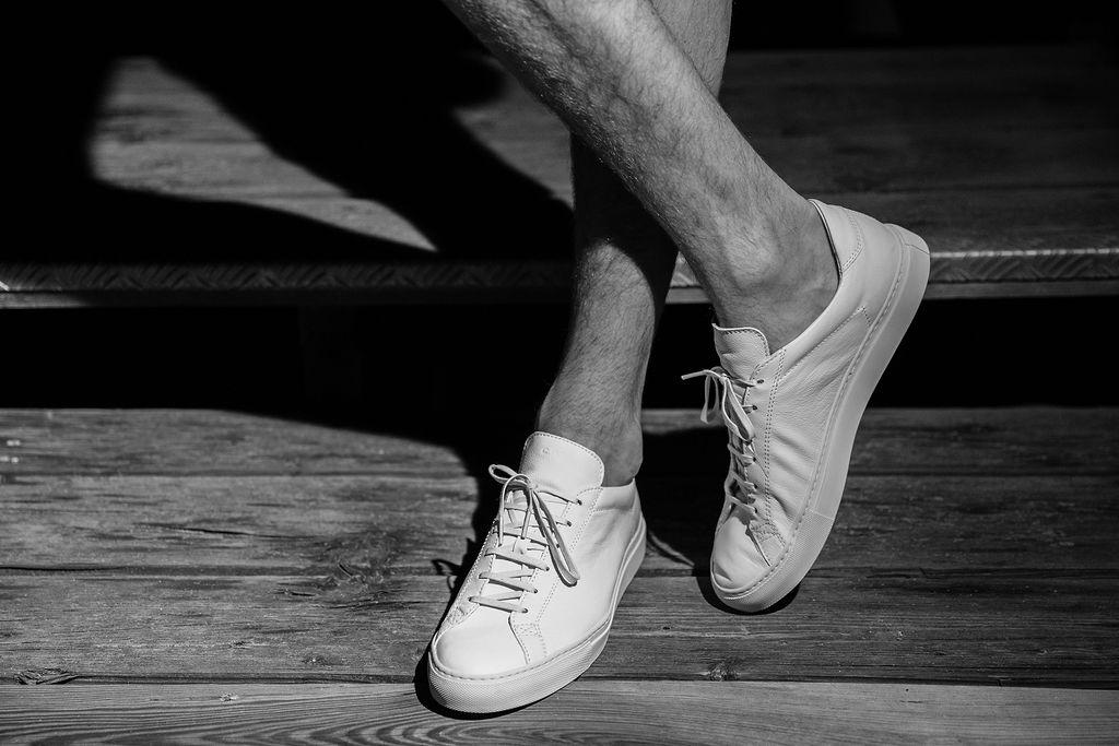 Harry wears  CQP Sneakers