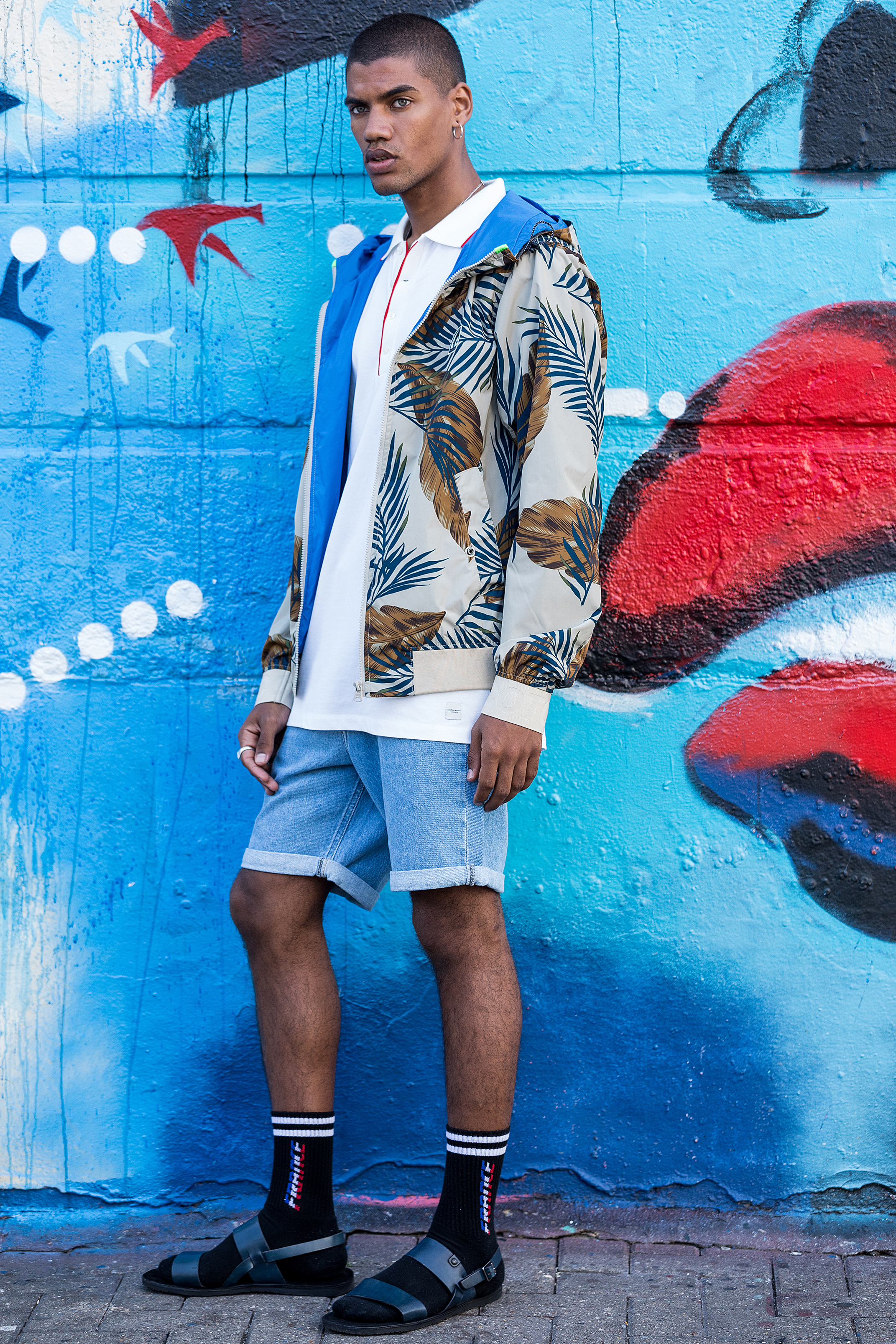 Nicolas wears  Lee shorts ,  Scotch & Soda polo & jacket  and  Base London shoes