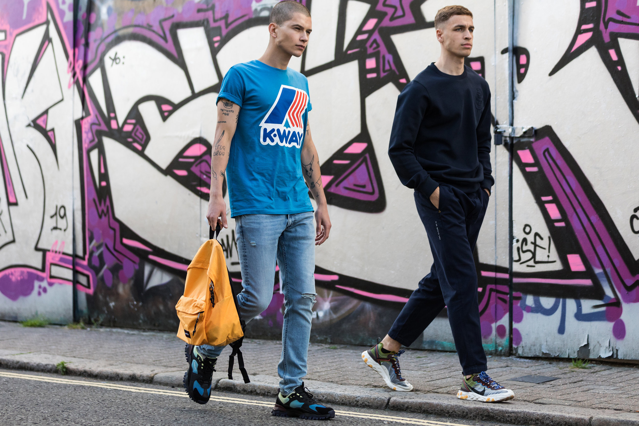 Lucas wears  K-Way T-shirt ,  Lee jeans ,  Umbro sneakers  and  Eastpak bag , Sam wears  Scotch & Soda  with  Nike sneakers