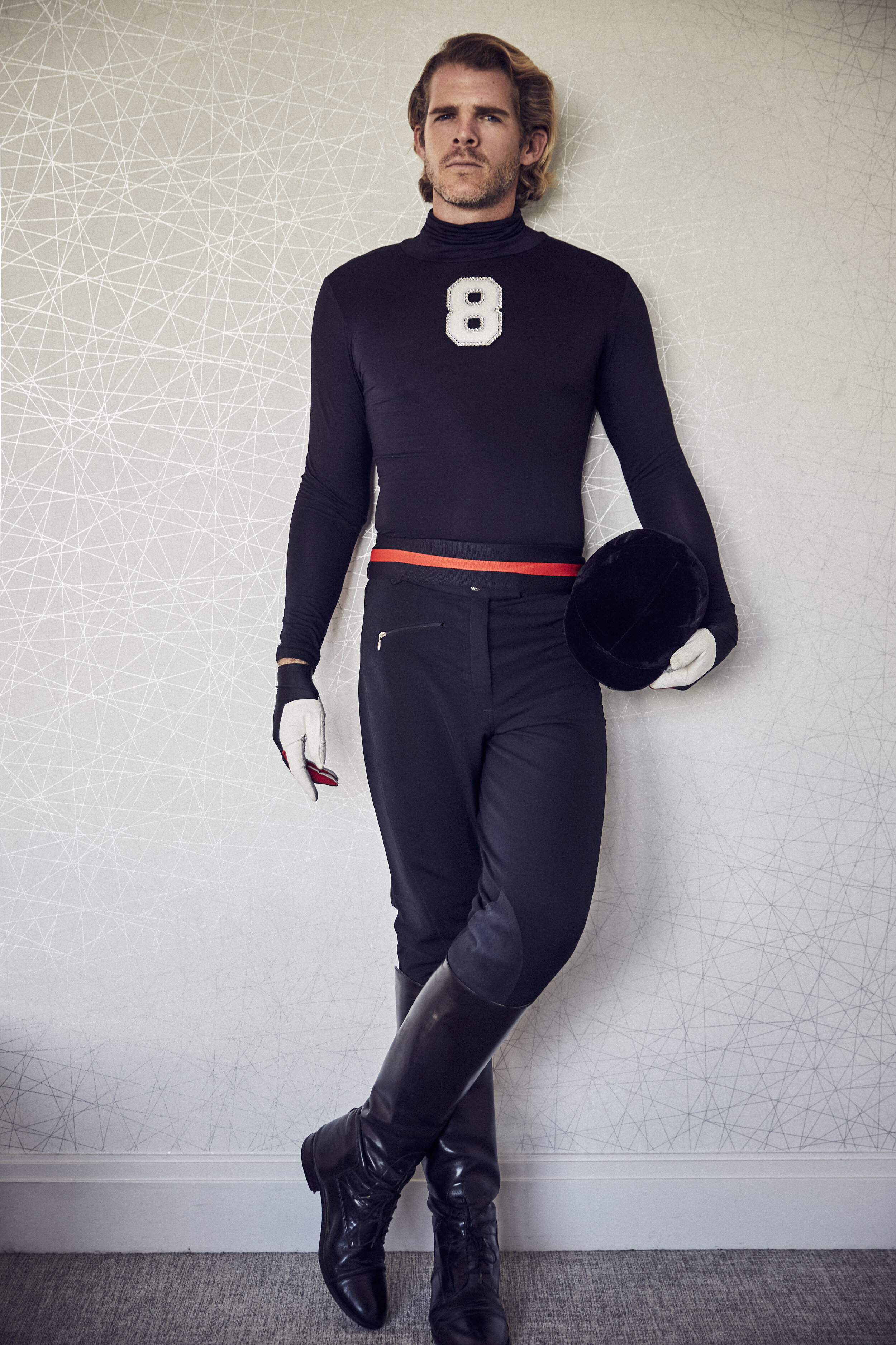"""Black Turtleneck with Crystal """"8"""" by  Michael Sui  Black, Vintage Riding Pants, Belt and Gloves by  Michael Sui"""