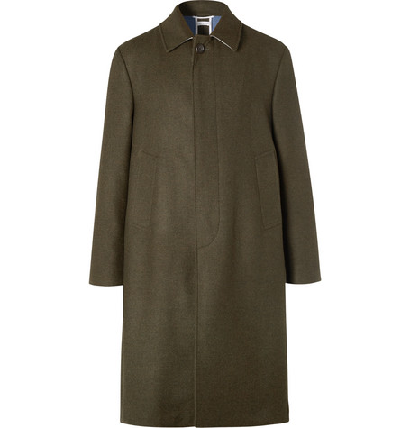Thom Browne wool coat at Mr Porter - £2,360 - Made in Japan, Thom Browne's coat is meticulously cut in an unstructured fit that's roomy enough for layering with knitwear. It's made from dark-green wool-twill and trimmed with the label's signature tricolour grosgrain along the back vent and cuffs. The concealed placket and tidy collar create a really neat profile.