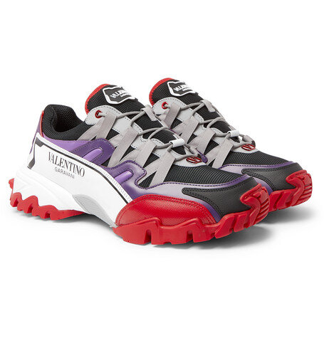 Valentino sneakers at Mr Porter - £590 - Inspired by hiking styles, but perhaps never worn by anyone that has ever hiked in their life, these new season Valentino's features leather and mesh in clashing black, red and purple.