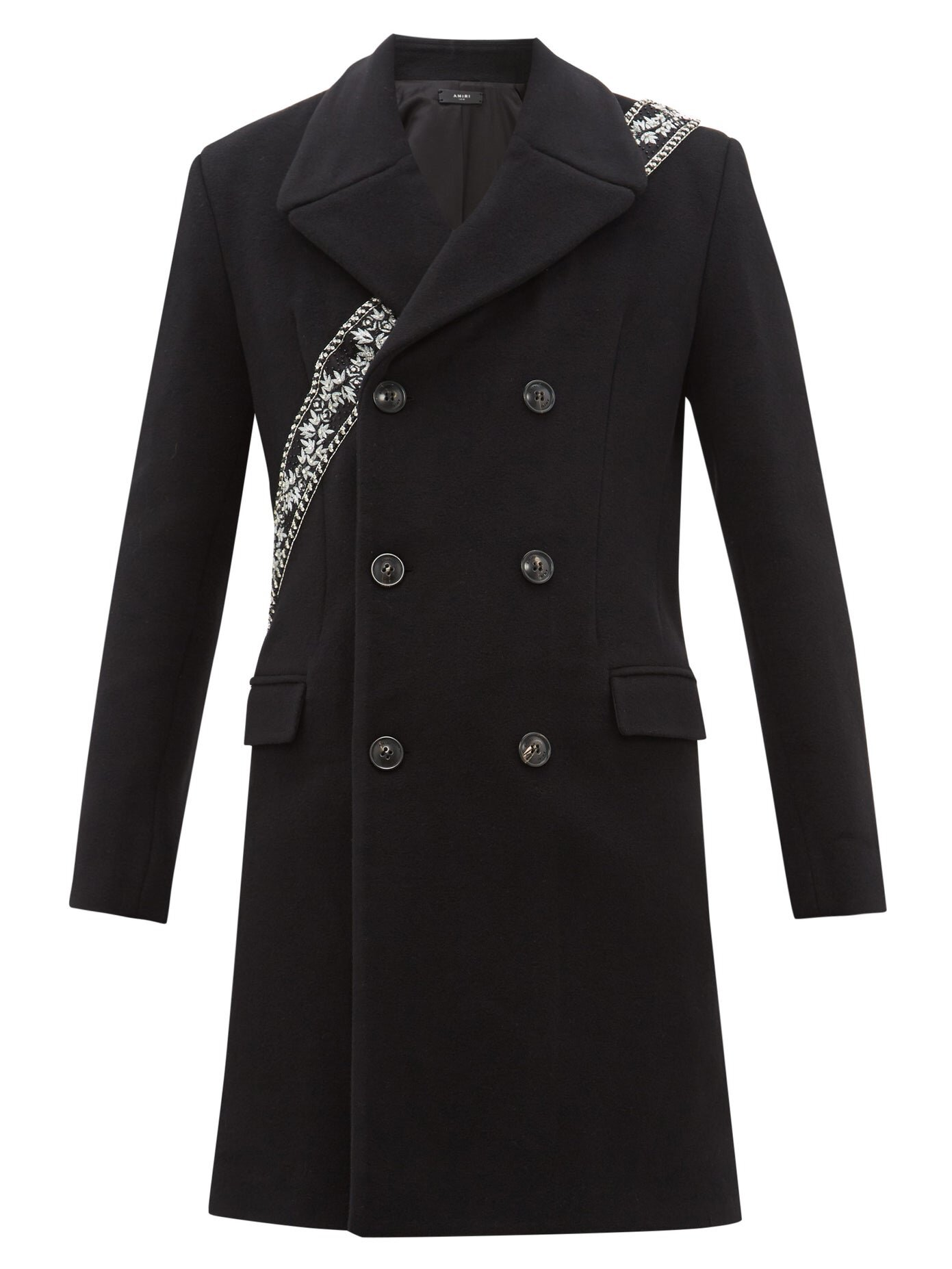 Amiri coat at Matches Fashion - £1,720 - Did you ever wish you could emerge from a tube station, effortlessly cool with a chic black overcoat and a guitar slung over your shoulder? This coat gets you there, without having to take a single guitar lesson.