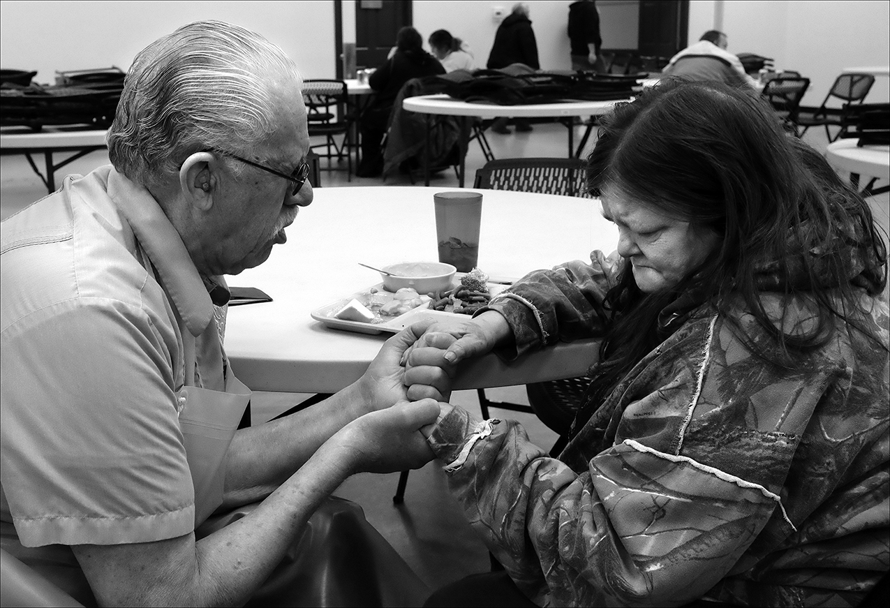 "February 2017:   A volunteer at the Horizons Soup Kitchen, prays with Brenda after her brother died the day before. ""The Horizons Soup Kitchen helps everybody out. They prayed with me, so I would feel more calm about losing my brother. They stand behind you. If you have a depressing situation or even need help with transportation, they're there for us like family,"" Brenda said."