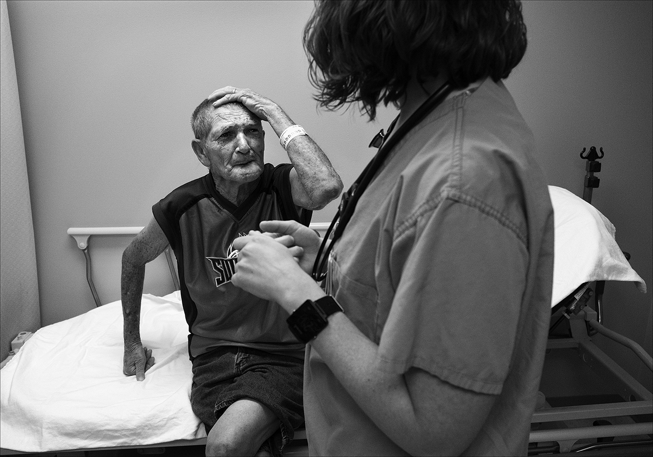 "June 2017:  Clarence explains to a Blessing Hospital emergency room nurse that he has had no relief from bed bug bites on his scalp and neck since March. Despite several trips to his doctor and the ER, the sores persisted. Some initial medication caused a severe burning sensation so the medication was changed. ""It took probably four or five months to get the right medication,"" Brenda said. ""Clarence got to picking at them so bad that he had a big visible scars on the top of his head, on the side of his face, and everything."""