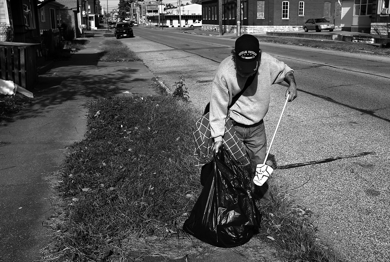 """October/November 2016  :  Since his injury in August, Dennis is working 30 hours a month for Township of Quincy General Assistance picking up trash to obtain $250 a month in rental assistance. Then he is suspended from receiving assistance because he didn't turn in work applications on time.  """"I was on their program, and I was given a list, a paper. It's a sign-off sheet for different companies, businesses, it's an employment sign-off sheet. It was really cold on Thursday, I remember. I didn't feel like running around filling out the applications. So I knew my appointment was on Monday morning at 8:30 to turn in my sign-off sheets. Well, I collected all my applications, like 12 of them filled them all out Thursday night. Friday morning, I got up to put it all together and get all my paperwork, and I couldn't find my sign-off sheet. I called General Assistance. They were closed. It was Veterans Day.  """"Monday morning I go in…to hand in my sign-off sheet, and I explained … I think I left it at one of the restaurants where I was filling out applications. The lady there (at General Assistance) told me because I hadn't turned in the sign-off sheet, that I was gonna be suspended from the program for 90 days, which they did. I told her if she could just give me another sign-off sheet I could have it back to her by 12 o'clock noon because most of the companies were right there at the mall and on the east side of Quincy, out in the industrial parks and stuff. … If they'd been at work on a Friday, Veterans Day, I could have gotten a sign-off sheet and I would've been all right for Monday. But they suspended me for three months, and that's what started the snowball escalating into an avalanche.''"""