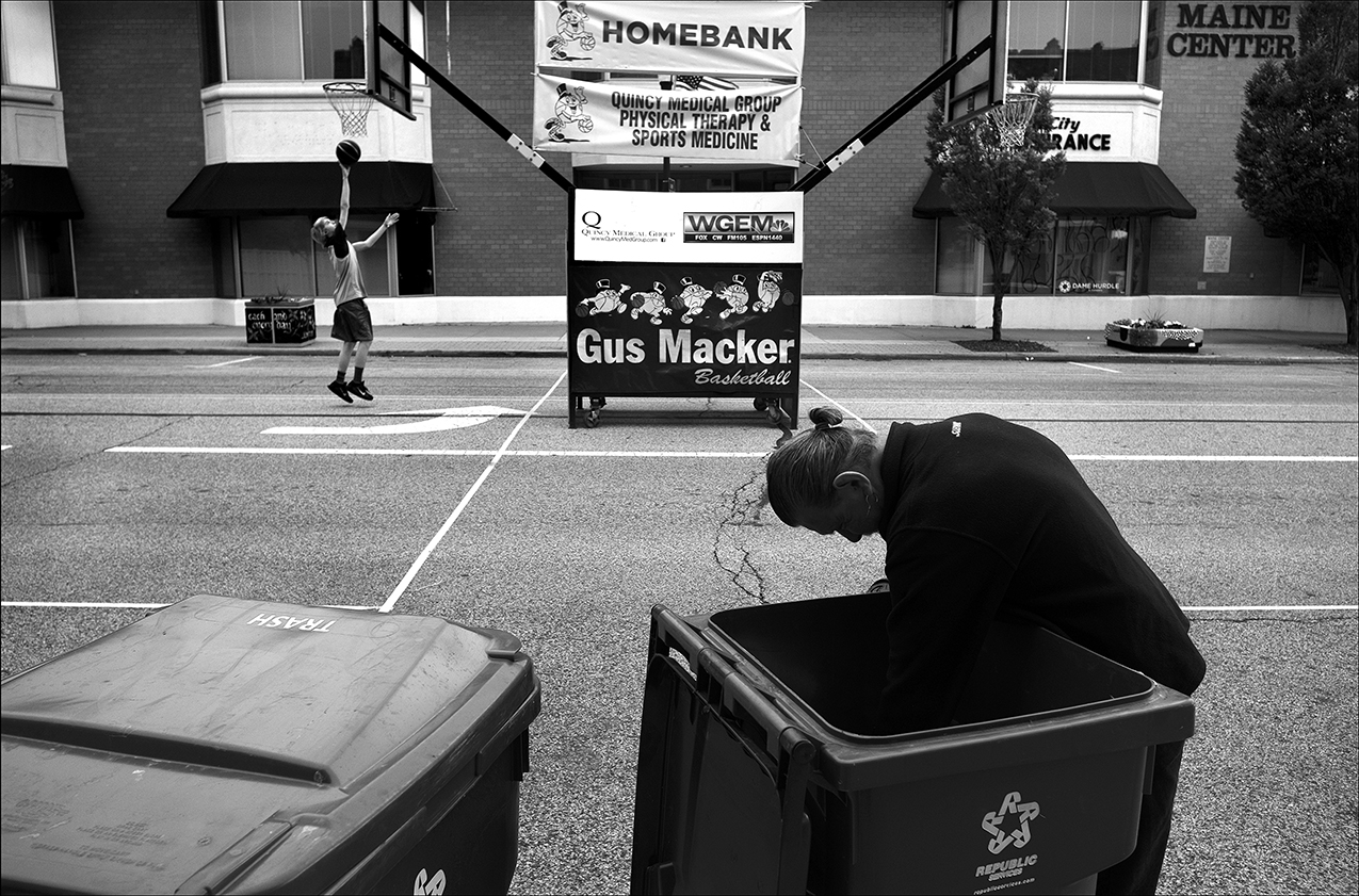May 2017:  During the week of the Gus Macker Tournament in Quincy, James sifts through garbage looking for an extra plastic bag to replace one that is torn. James says once a Quincy police officer was going to take him to jail while he was getting food out of a dumpster, but when another officer intervened, he was only given a ticket for having a hole in the backside of his pants. He says he has to go to court over that.
