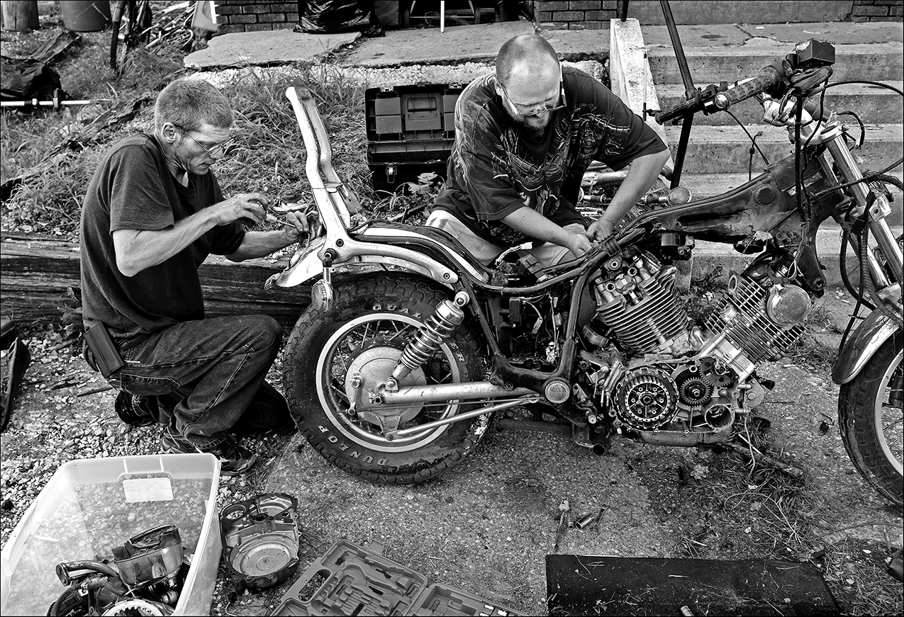 """August 2016:  James helps a friend tear down a motorcycle for parts. """"I just try and help out whoever I can. If I see somebody needing help, I'll stop and do it. I don't even have to be paid for it; it's giving me something to do to help others,"""" James said."""