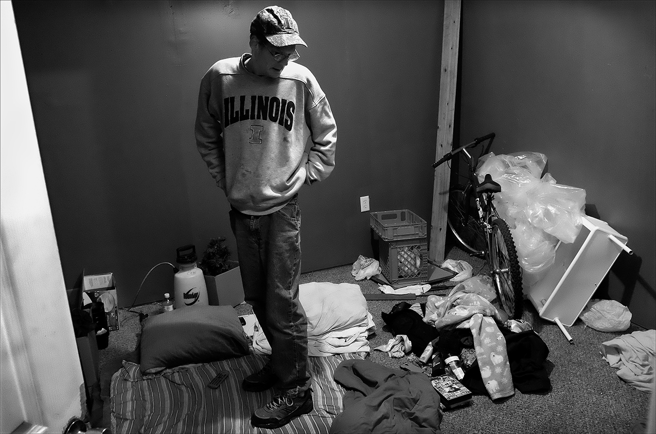 "January 2017:  James stands in the center off his room in an apartment he now subleases with friends. After nearly a year of being homeless, James seems to have found a place that may work out for him. ""I've come a long way from my little spot in the woods,"" James said."