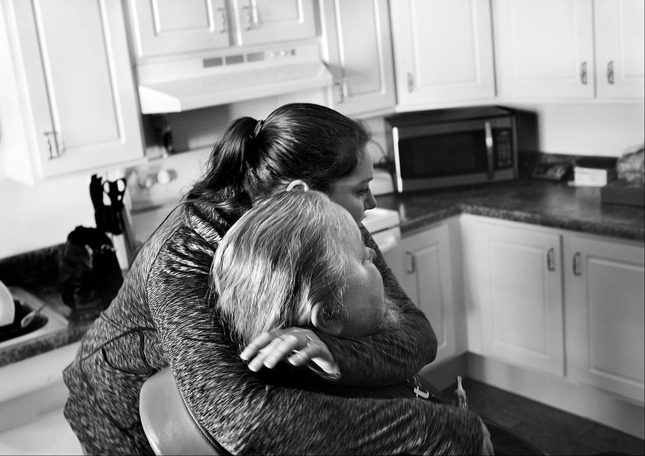 March 2017:  Mark receives a hug from a friend who came by to see him in his apartment about a week before he died of a heart attack. Mark died April 6, 2017, just six days before his birthday. Days later, the family is selling Mark's belongings to raise money for his burial expenses, but a basic funeral service is out of their price range.