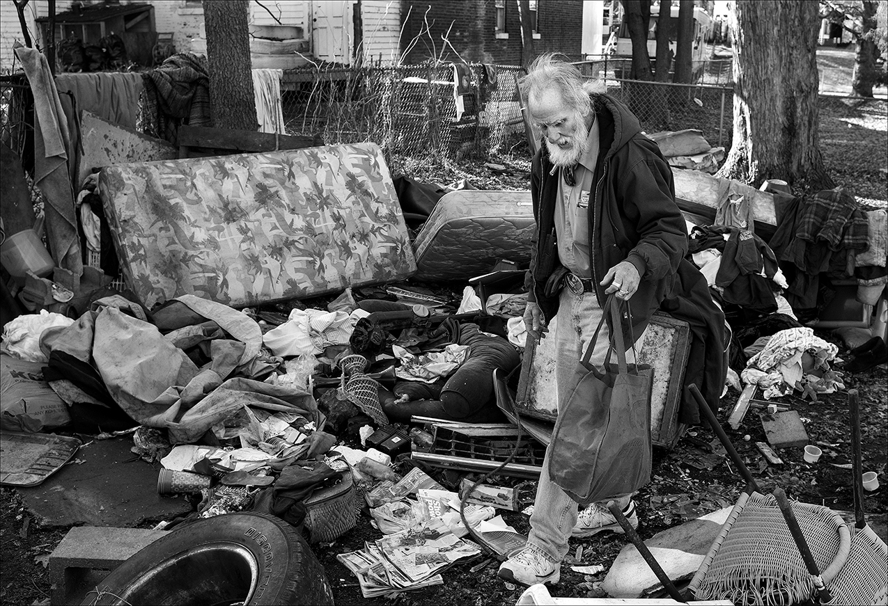January 2018:  Walter stayed away from the rental house for about a month because of what he said were threats made by the landlady's son. Walter returned in January to find the shelter torn down and Walter's belongings trashed. His clothes are wet and mildewed. His small collection of art supplies is ground into the mud with much of his other person property. After confrontations with the son and a stay in the Veterans Hospital in Iowa City, Iowa, Walter is able to return to the rental house but it still does not have heat or electricity. Walter said he applied for public house but was told there was a two- to three-month waiting period. Walter says he can't find a place he can afford on his $681 monthly Social Security retirement check.