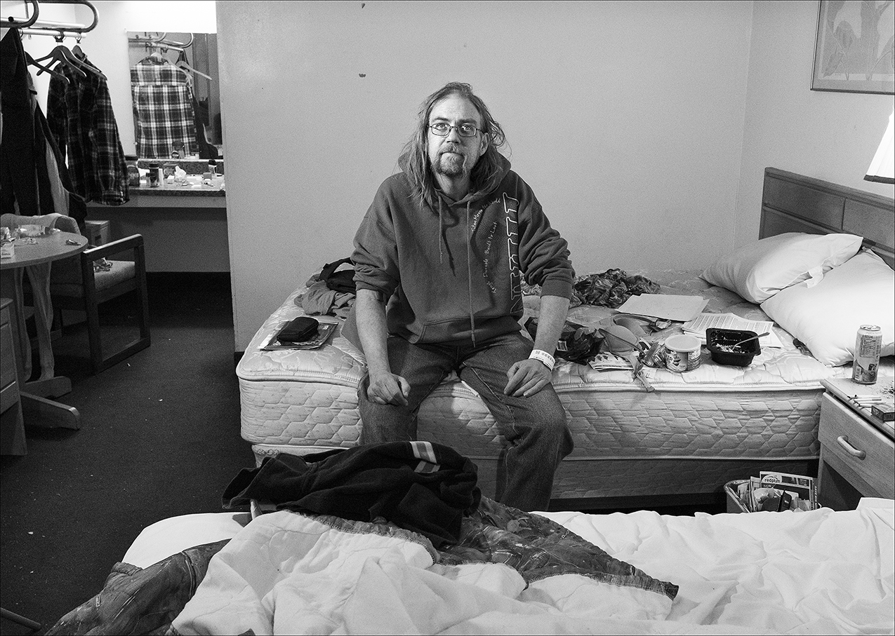 February 2018:  Wes sits in a room at the Welcome Inn. He was given a voucher to stay at the motel for a week at a time at $145 a week and he's been there for six weeks. Several social service agencies provide people with vouchers to stay at the Welcome Inn. However, those who live in motels don't have the same protections as those who have a rental lease agreement. A person can be told to leave for virtually any reason, without recourse, or be charged with trespassing. Those lucky enough to get a voucher stay a week at a time and when their time is up they are back on the streets again. Wes left the motel after his six weeks were up. He says he called the Salvation Army for help but was told it didn't have the funds. Wes says despite his requests, during his entire six-week stay at the Welcome Inn, he was wasn't provided with clean linen once a week, or weekly room cleaning as advertised.