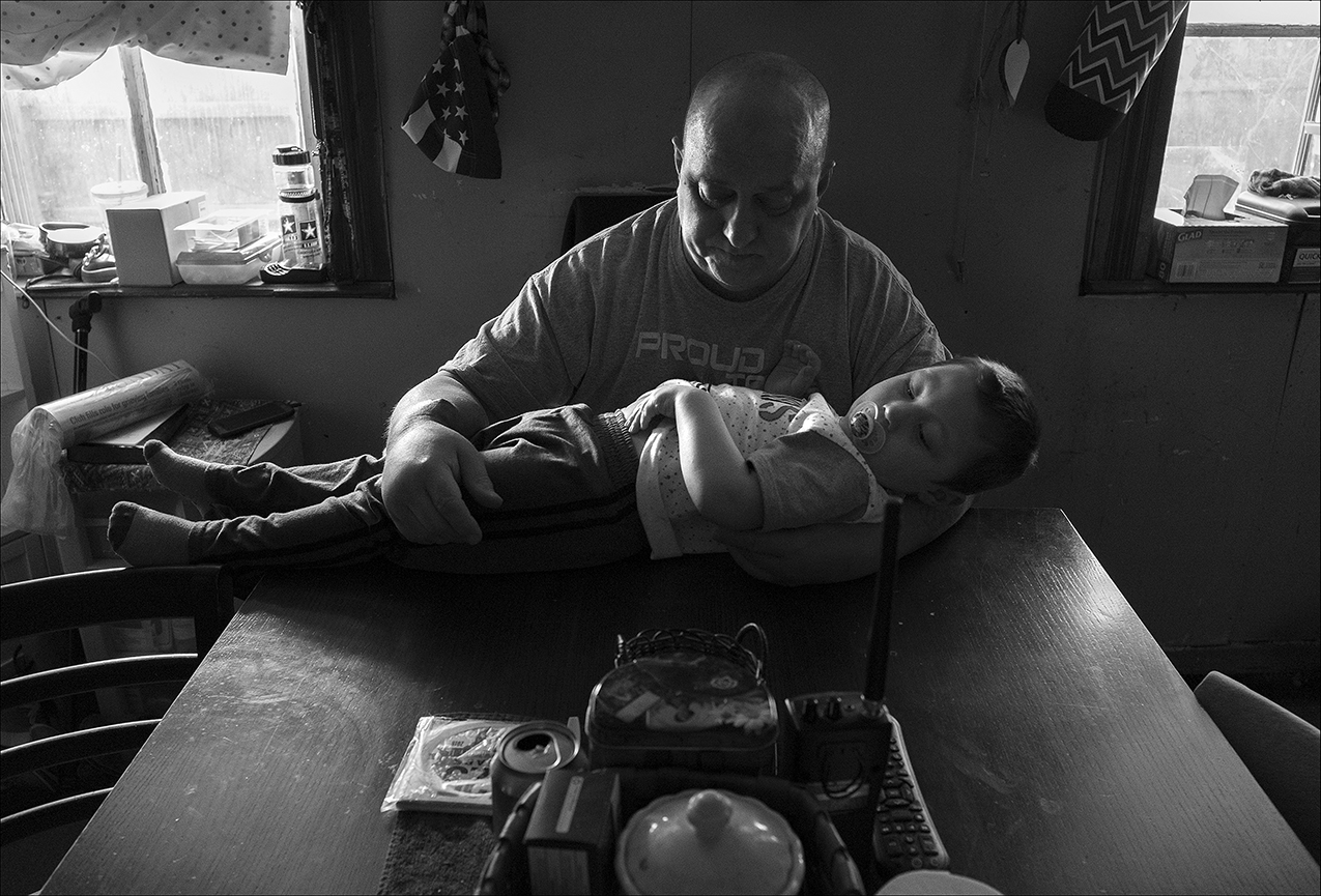 "December 2017:  Chris tries to quiet his grandson Carson, so he'll take his afternoon nap but receives bad news, his cancer has returned and spread to his lungs. ""The cancer came back and it's in my lungs. Since then, they've had me on three different kinds of drugs trying to cure it,"" Chris said. ""I've had three different kinds of chemo. So far, they said it ain't spreading nowhere. It's still in my lungs. It's gotten a little bigger, but not much. Right now, I'm fighting it. They got me on oxygen. All I'm doing now is just fighting it one day at a time. It's hard. Sometimes I want to give up and sometimes I don't. I'm in a depression, I guess. I don't know what it is. I hate putting my family through all this. It hurts. I've got grandkids now. I don't know. I don't even know if I can do it anymore. This cancer is taking a toll on me. So, I don't know what to do."""