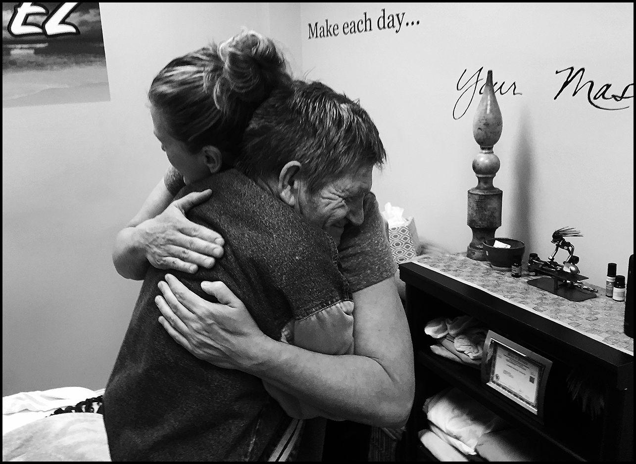 April 15, 2018:  Andy receives a hug from licensed massage therapist Shannon Lewis, Breathe EZ Massage in Quincy, after enjoying a complimentary hour-long massage by Lewis, recently. Shannon Lewis gave away massage gift cards to 3 individuals who otherwise couldn't afford such an amazing experience. Andy has had a rough year, especially after the sudden death of his fiancée. Shannon's spirit of giving is an incredible example of how we can use our talents and skills to bring joy into the lives of those who are often marginalized. Thank you Shannon.