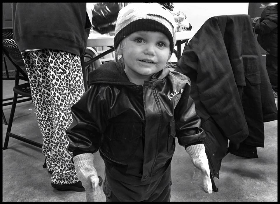 """November 2018:  Zander, 2, is one of several individuals who received a warm hat and gloves from an unknown donor today. The individual gave more than a dozen hats, gloves and scarves to a homeless gentleman in Washington park today, who then handed out the items to people in need at the Horizons Soup Kitchen. This is a small but magnificent gesture by the person who packaged these items for those in need and an example of people working together to help others. Thanks! Here's what Zander's mom had to say: """"It's nice to see love and faith and hope and charity alive in today's world. A little kindness goes a long way."""""""