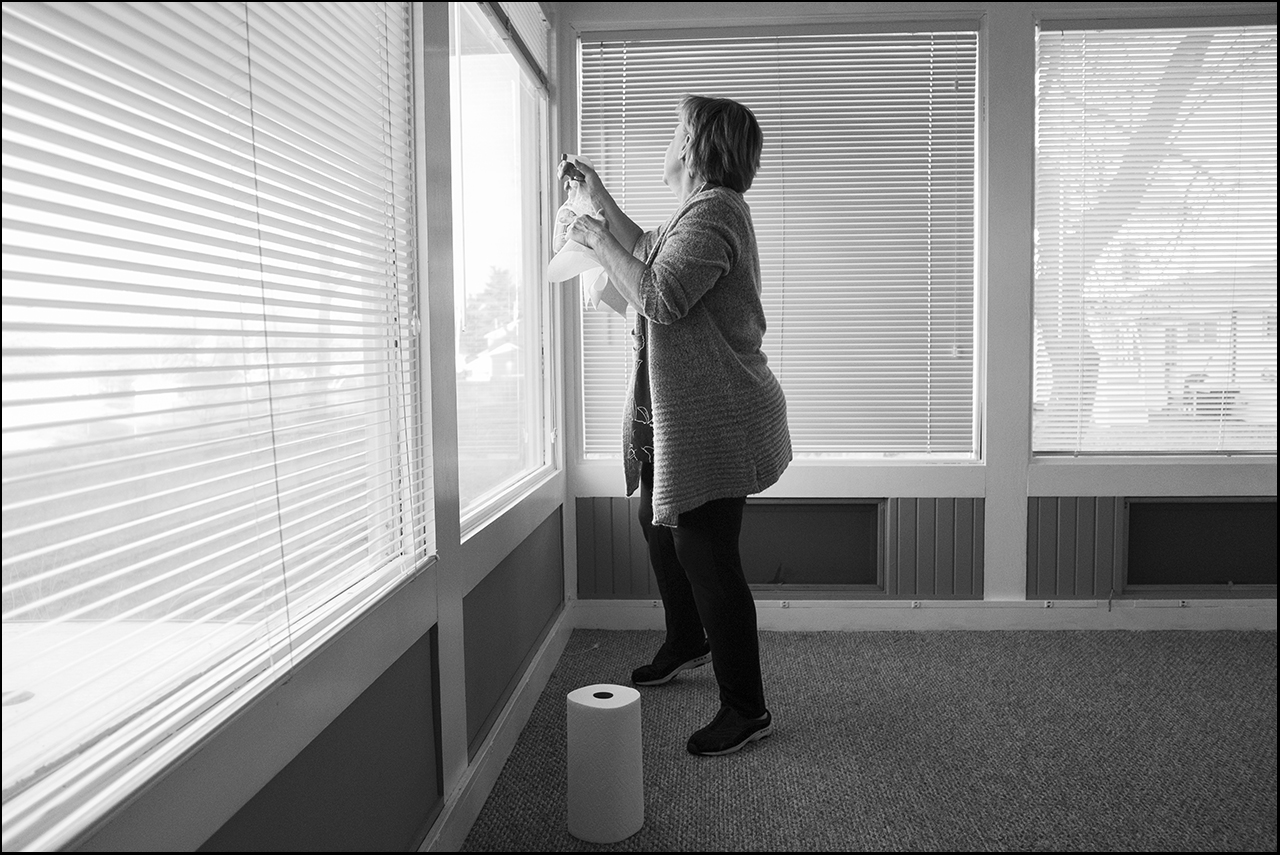 In preparation for Becky and sons temporary move to a house for the winter, a generous volunteer does some general cleaning, Sunday December 16, 2018, in Quincy, Illinois. The family plans to move into the house Tuesday, December 18, 2018.