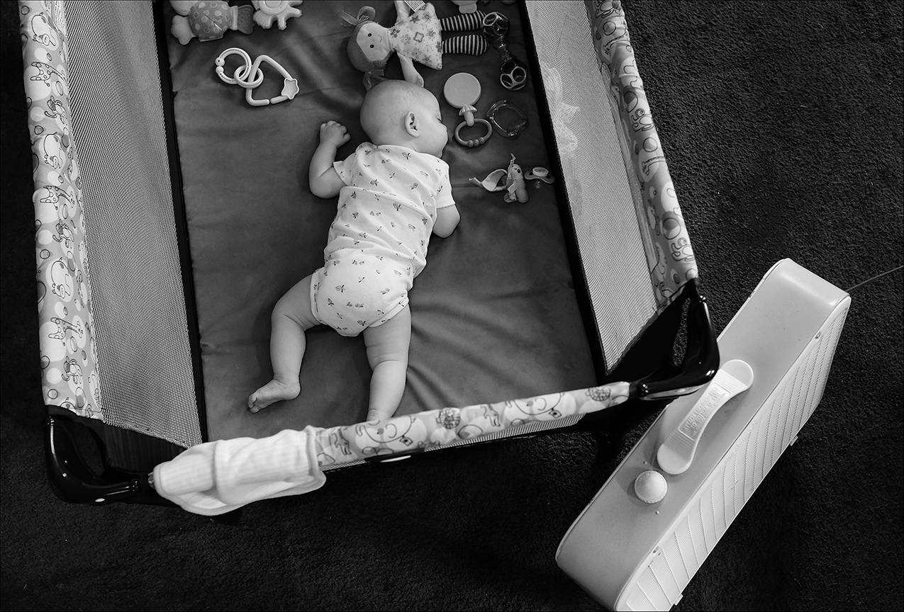 August 2018:  With a box fan nearby to keep cool, a three-month-old infant sleeps in her playpen. Not one outlet in the rental is able to handle the electrical load of even a small air-conditioner window unit. With no central air, or window unit, temperatures in the apartment reach 98 degrees. The landlord refused to install a dedicated electrical line to handle a window unit, because he didn't want to spend the money for it. Meanwhile the family of 7 suffer through the high temperatures. The rest of the apartment has more problems including leaking water lines, which have caused months of water bills exceeding $230 per month. With no resources to find another place to rent, the family makes due living in a dangerous substandard dwelling.