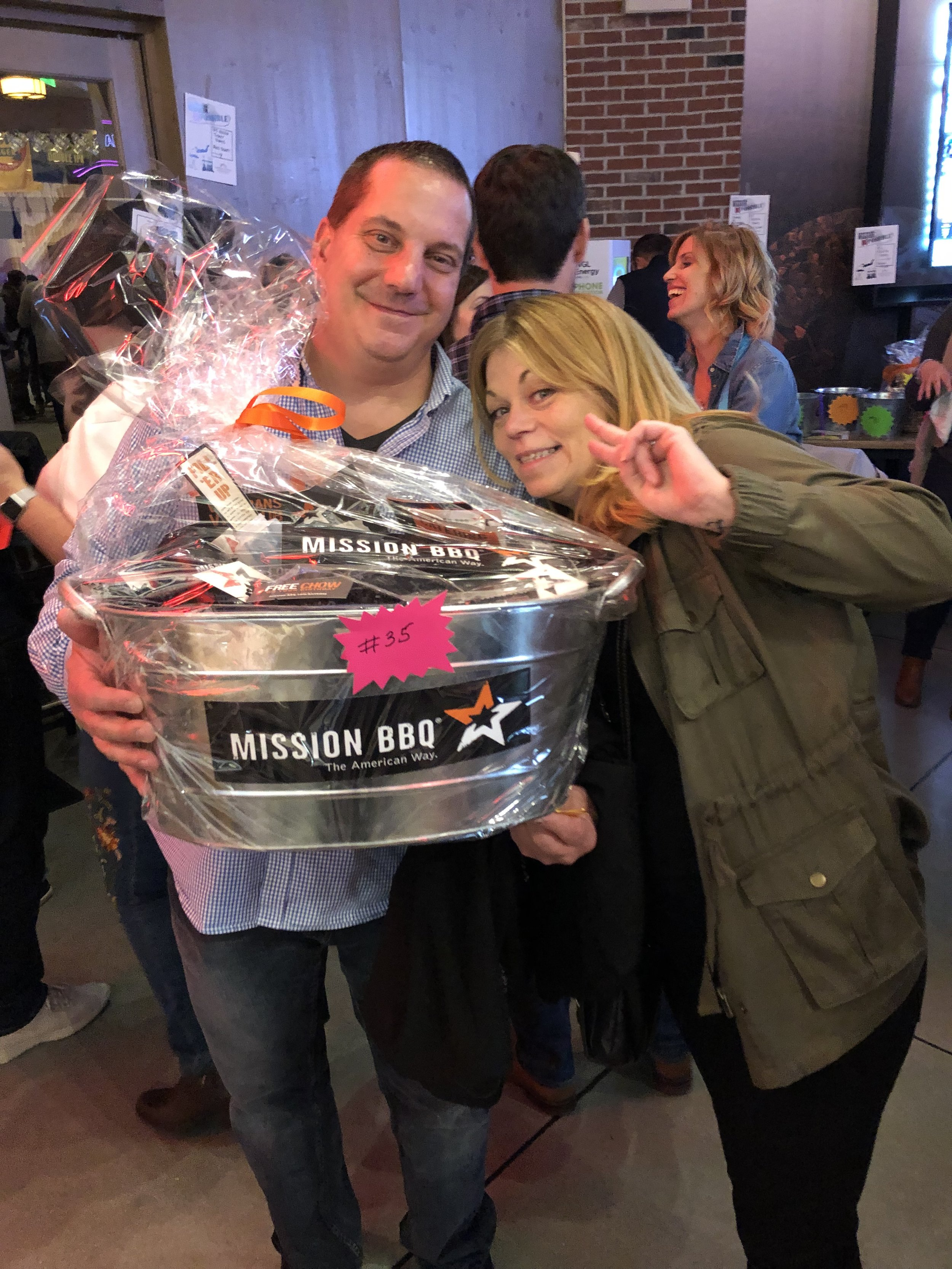 Paul and Lisa won the Mission BBQ basket