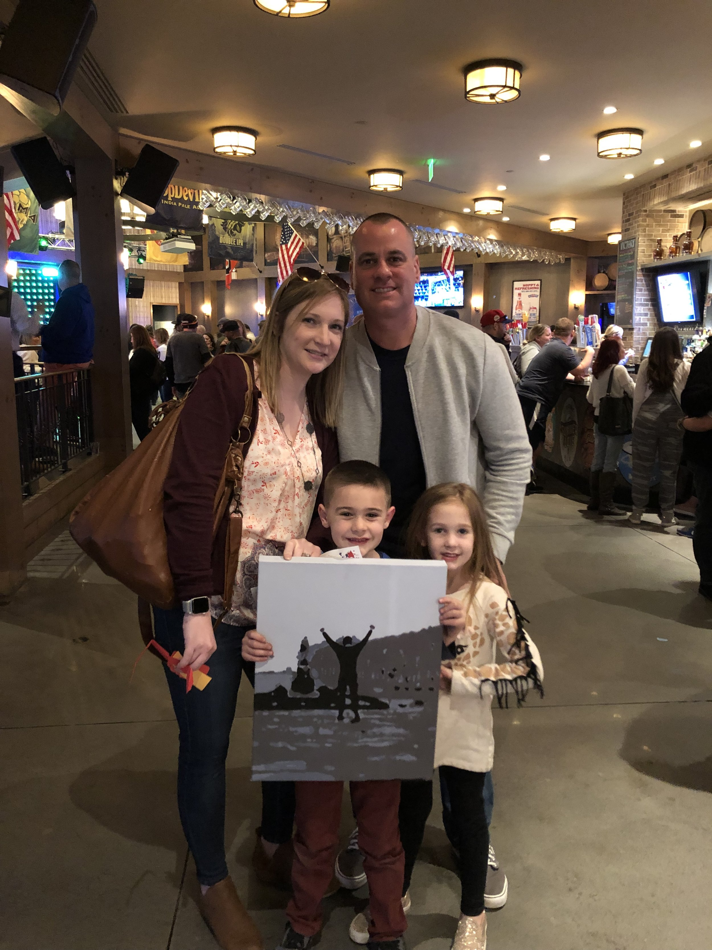 The Malone family won a custom Rocky painting by Kate Conway